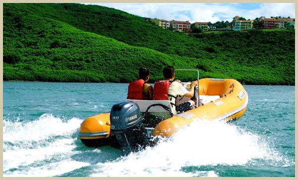 Mini Boat tour passing by El Conquistador Resort