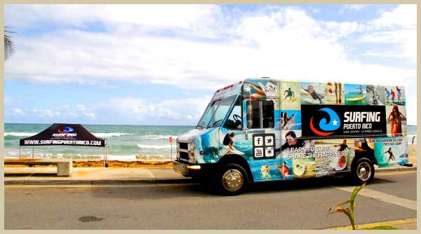 surfing in puerto rico van truck parked at La Pared Beach in Luquillo, Puerto Rico, ready for surfing lessons puerto rico and surf rentals puerto rico