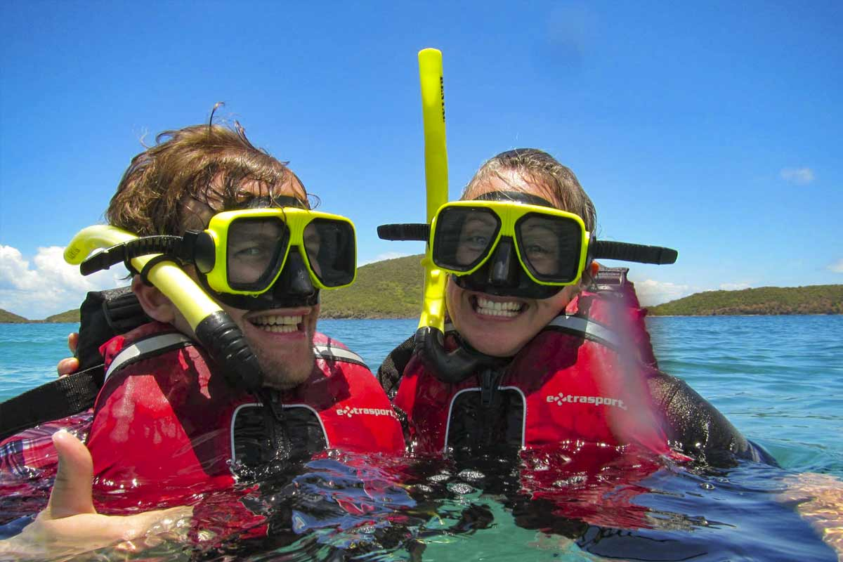 Man and woman smile while snorkeling in culebra with Kayaking Puerto Rico culebra snorkeling tour